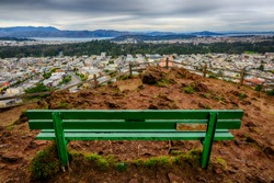 City View and Alone Green Bench in Grand View Park of San Francisco, California