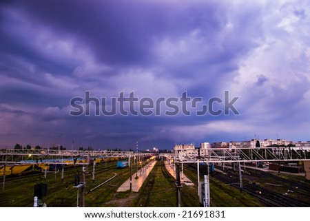 city view and railway station wirh storm clouds