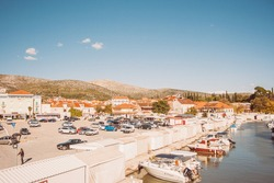 City view with boats in the harbor, mountains in the distance. Sunny summer day in Croatia. summer landscape