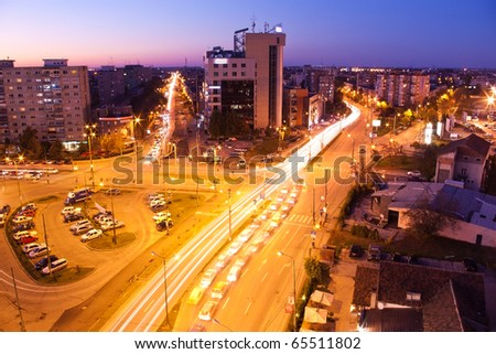 city with crossroads and parking after sunset