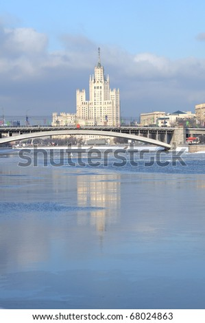 citycsape with white skyscraper on a river - stock photo