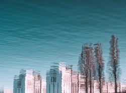 Cityscape. Abstract reflection of town in water. Abstract distorted house elements in water. Blue water surface. Cityscape distorted in the river. Blue wave background. Layout or template of abstract