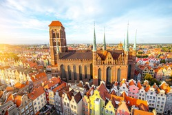 Cityscape aerial view on the old town with saint Marys church on the sunset in Gdansk, Poland