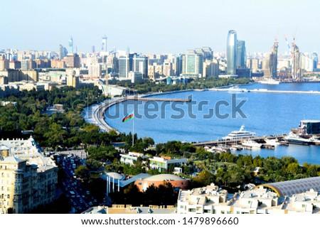 Cityscape and coastline of Baku with caspian sea. Panoramic view of caspian sea from Baku National Overhead Park. Bird eye view of Baku city coast and caspian sea. Baku aerial panoramic view.
