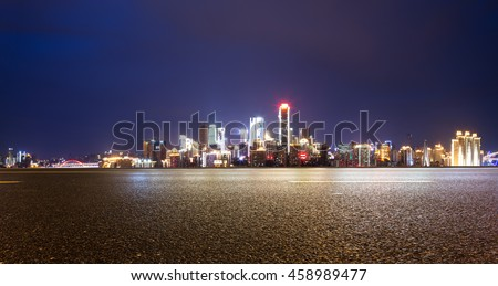 cityscape and skyline of chongqing at night on view from empty asphalt road #458989477
