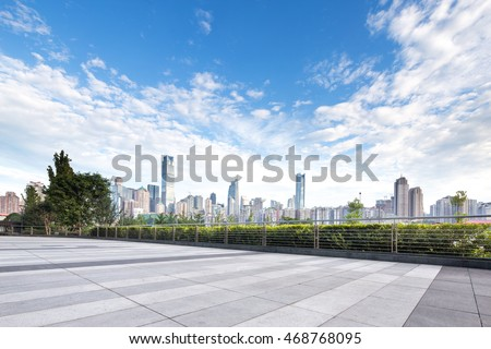cityscape and skyline of chongqing in sunny day from empty brick floor