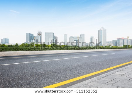 cityscape and skyline of nanjing from empty asphalt road