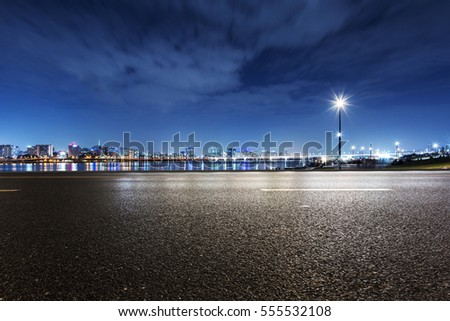 cityscape and skyline of seoul from empty road at night