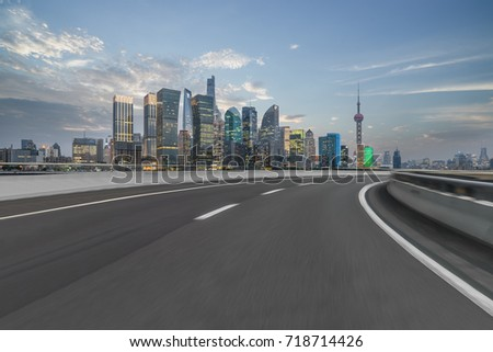 cityscape and skyline of shanghai from empty asphalt road #718714426