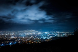 Cityscape at night. Cloudy night sky.
