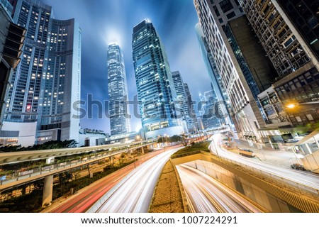 Cityscape at Night in Hong Kong with fast traffic and skyscrapers of the Central District #1007224291