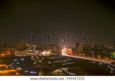 Cityscape  at night. traffic in Baku, Azerbaijan, cars movement at the central Heydar Aliyev Avenue near centre