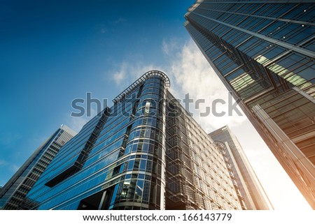 Cityscape featuring modern office exterior from a low angle at sunset. #166143779