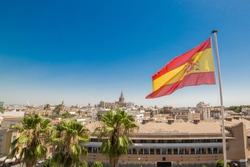 Cityscape from high of Seville cathedral with Spain flag waving in Sevilla , Spain