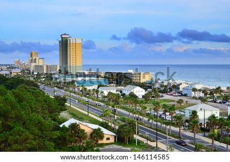 stock-photo-cityscape-image-of-panama-city-beach-florida-along-front-beach-road-at-dusk-146114585.jpg