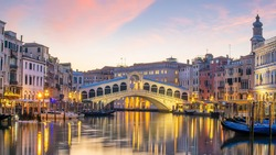 Cityscape image of Venice, in Italy during sunrise with Gondolas