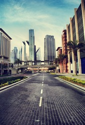 Cityscape in retro style. Dubai downtown street with skyscrapers. Modern road and urban buildings view.