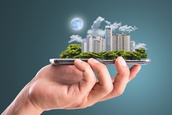 Cityscape intelligent building ,hold smart phone for build and make your green city.
