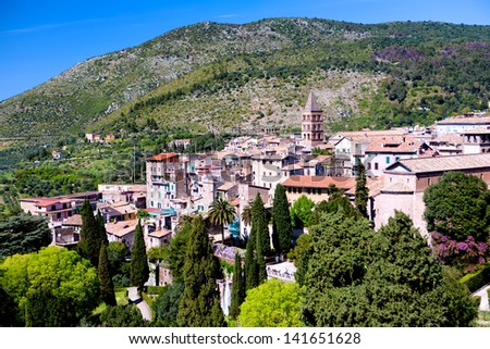 cityscape - landscape of a little italian town - rooftops and mountains in the background