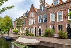 Cityscape Leiden street view with typical Dutch gable houses and canal in the old city centrer of Leiden in the Netherlands
