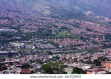 Cityscape Medellin. Shanties built on the slopes of the mountains. Homes townships. Colombia.