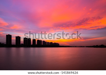 CItyscape modern residential building near the Bangkok sunset sky beautiful.