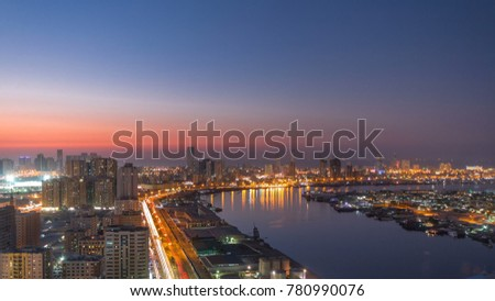 Cityscape of Ajman from rooftop from day to nigh transition timelapse with lake. Ajman is the capital of the emirate of Ajman in the United Arab Emirates. 4K Сток-фото ©
