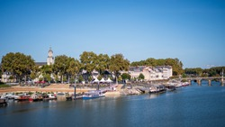 Cityscape of Angers, a city located in western France. View on the Maine river. Sunny day, blue sky.