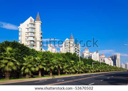 Cityscape of asian city viewed from a sidewalk of highway