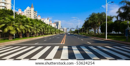 Cityscape of asian city viewed from zebra or pedestrian crossing #53624254
