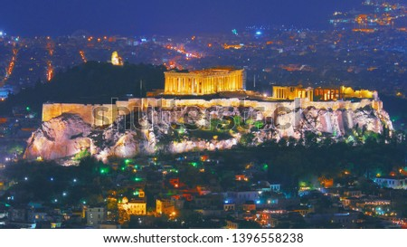 Cityscape of Athens with illuminated Acropolis hill, Pathenon and Herodium construction and sea at night. Athens skyline at night viewed from mount Lykavitos with Acropolis, Greece. Shot in dusk