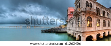 Cityscape of building on dock with beautiful bridge and ocean in Macao, China.