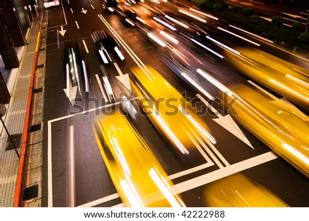 Cityscape of cars motion blurred with light in the night.