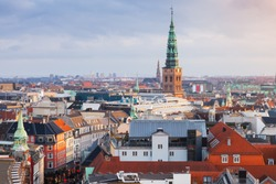Cityscape of Copenhagen with spire of City Hall, Denmark. Photo taken from The Round Tower, popular old city landmark and viewpoint