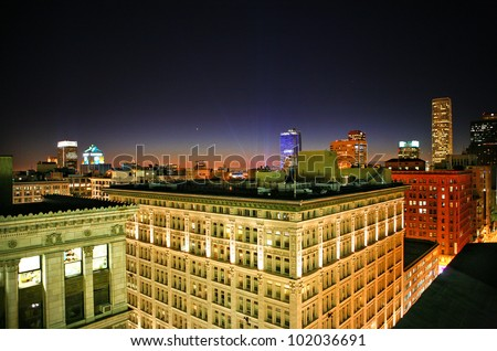Cityscape of Downtown Los Angeles and Hollywood lights at night from rooftop