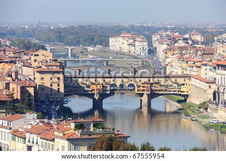 Cityscape of Florence, Italy. Aerial view with famous Ponte Vecchio over Arno river.