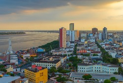Cityscape of Guayaquil city at sunset with the Guayas river and skyscraper skyline, Guayaquil, Ecuador.