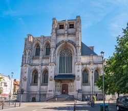 Cityscape of Leuven, Belgium. Beautiful historical buildings, with their famous facades and Saint Peter's Church  in the old town .