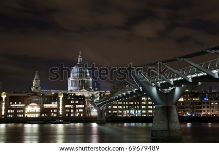 Cityscape of London at night with Millenium bridge and St Paul cathedral, England