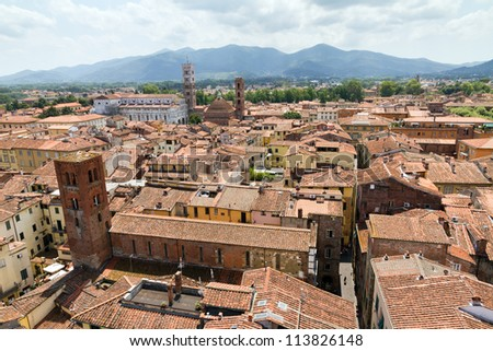 Cityscape of Lucca, Italy. Seen from the Torre delle ore with the Lucca cathedral in the background
