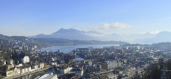Cityscape of Luzern, Switzerland with lave and mountains