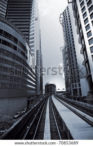 Cityscape of modern buildings and railway in city center.