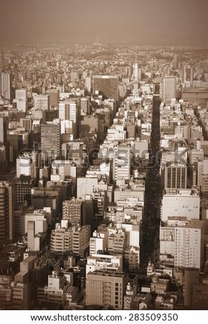 Cityscape of Nagoya, Japan. Vintage style sepia image.