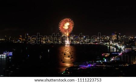 Cityscape of night skyline Pattaya City and Colorful fireworks. Celebration and anniversary concept. Pattaya International Fireworks Festival 2018 at Pattaya beach  on twilight background, Thailand. #1111223753