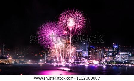 Cityscape of night skyline Pattaya City and Colorful fireworks. Celebration and anniversary concept. Pattaya International Fireworks Festival 2018 at Pattaya beach  on twilight background, Thailand. #1112000009