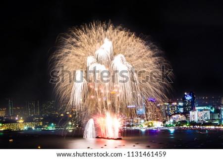 Cityscape of night skyline Pattaya City and Colorful fireworks. Celebration and anniversary concept. Pattaya International Fireworks Festival 2018 at Pattaya beach  on twilight background, Thailand. #1131461459