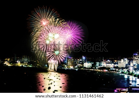 Cityscape of night skyline Pattaya City and Colorful fireworks. Celebration and anniversary concept. Pattaya International Fireworks Festival 2018 at Pattaya beach  on twilight background, Thailand. #1131461462