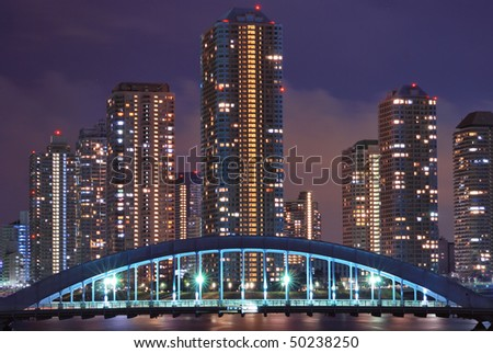 cityscape of night Tokyo Metropolis, modern skyscraper buildings at Tsukishima district and Eitai bridge