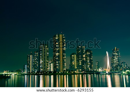 cityscape of night Tokyo, modern district buildings at Tsukishima district