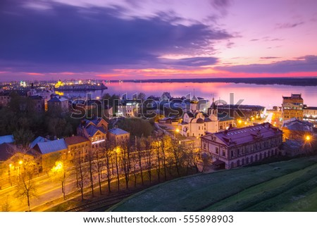 Cityscape of Nizhny Novgorod to the Volga River and the mouth of the Oka River from the Kremlin hill in the twilight after sunset